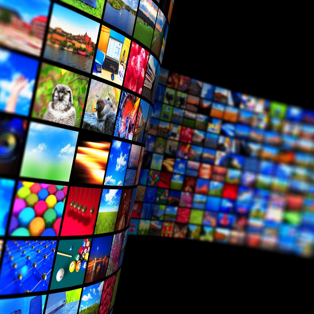 Creative abstract web streaming media TV video service technology, multimedia business internet communication and cinema content production concept: 3D render illustration of black background with endless walls of screens with color photos and colorful displays with different images